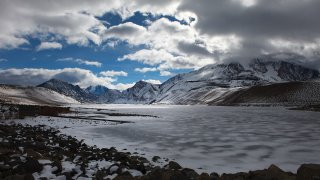 Clouds drift over a frozen Grant Lake Reservoir in a view from the lake's dam January 29 2012 in th