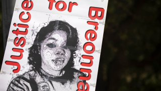 A demonstrator holds a sign demanding justice for Breonna Taylor, Sept. 19, 2020, in Austin, Texas.