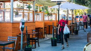 People pass by the parklet at Zazie restaurant in Cole Valley.