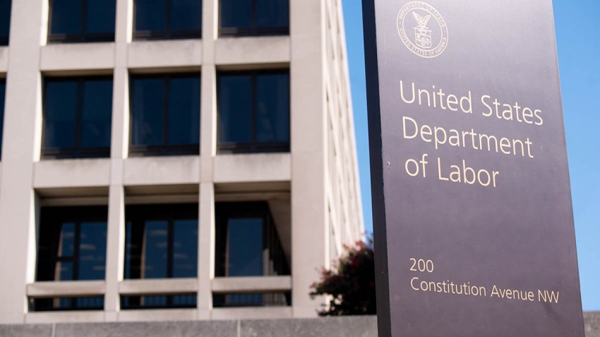 Signage is displayed outside the U.S. Department of Labor building in Washington, D.C., Aug. 18, 2020.