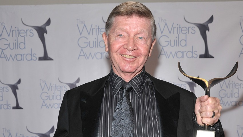 In this Feb. 7, 2009, file photo, writer William Blinn, winner of the Paddy Chayefsky Laurel Award, poses at the 2009 Writers Guild Awards press room at the Hyatt Regency Century Plaza Hotel in Los Angeles, California.