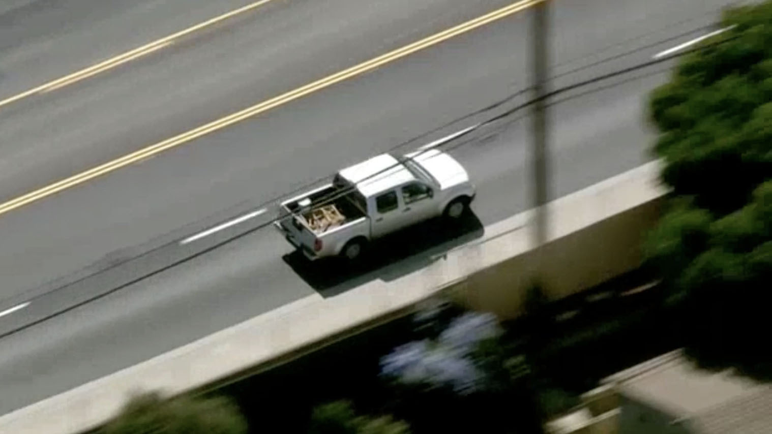 After Standoff Outside Shopping Center, Pickup Driver Takes Off in High-Speed Chase