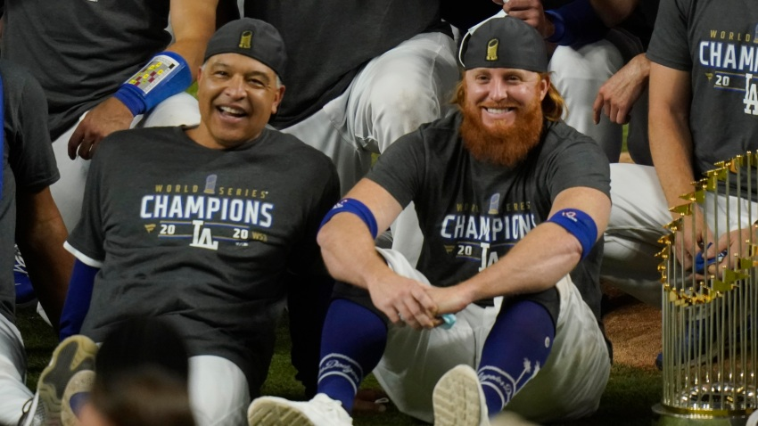 Los Angeles Dodgers manager Dave Roberts and third baseman Justin Turner pose for a group picture after the Dodgers defeated the Tampa Bay Rays 3-1 in Game 6 to win the baseball World Series, Tuesday, Oct. 27, 2020, in Arlington, Texas.