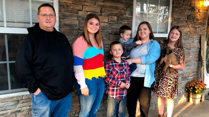 Keith Michael, left, poses with his children, from left, Jessica, Hunter, Houston, Sara and Holly, outside their home on Friday, Nov. 13, 2020, in Jonesboro, Ark.