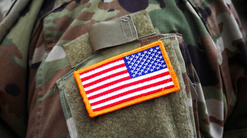 An American flag patch is seen on the uniform of a U.S. Army soldier during a ceremony in Krakow, Poland, Aug. 4, 2020.