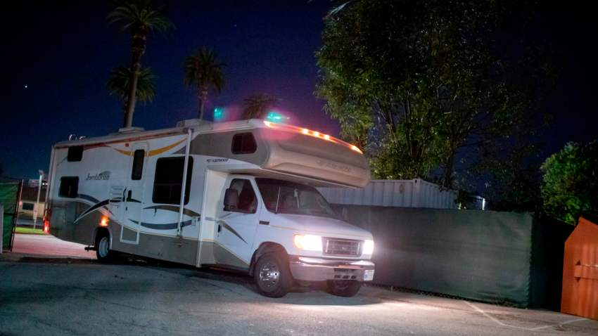 A RV pulls into a Safe Parking lot in Los Angeles.