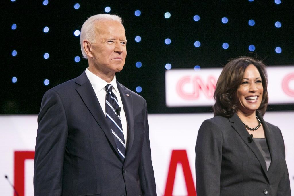 Joe Biden and Kalama Harris stand on stage.