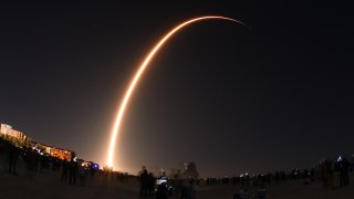A SpaceX Falcon 9 rocke lifts off.