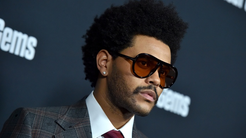 """In this Dec. 11, 2019, file photo, The Weeknd attends the premiere of A24's """"Uncut Gems"""" at The Dome at ArcLight Hollywood in Hollywood, California."""