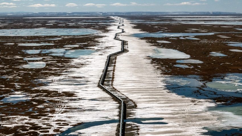 An oil pipeline stretches across the landscape outside Prudhoe Bay in North Slope Borough, Alaska