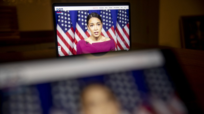 Representative Alexandria Ocasio-Cortez, a Democrat from New York, speaks during the virtual Democratic National Convention seen on a laptop computer in Tiskilwa, Illinois, U.S., on Tuesday, Aug. 18, 2020. The DNC, which began Monday and ends Thursday with Joe Biden accepting the nomination for president, will be almost entirely virtual with speakers delivering addresses from around the U.S. that will be streamed on the internet.