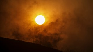Sun sets in heavy smoke from Blue Ridge fire on October 27, 2020 in Chino Hills.