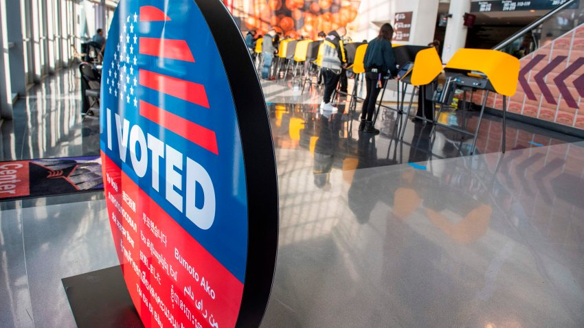 People vote at Staples Center.
