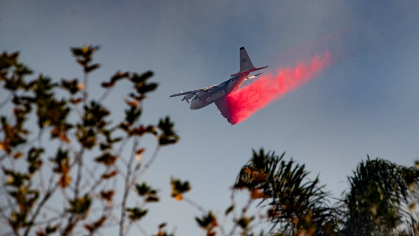 A fire-fighting jet makes a drop.