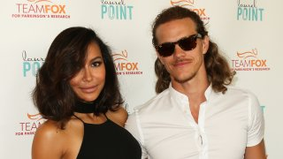"""STUDIO CITY, CA - JULY 27: Actors Naya Rivera (L) and Ryan Dorsey (R) attend the """"Raising The Bar To End Parkinson's"""" at Laurel Point on July 27, 2016 in Studio City, California."""