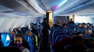 Masked passengers, aboard a Hawaiian Airlines flight.
