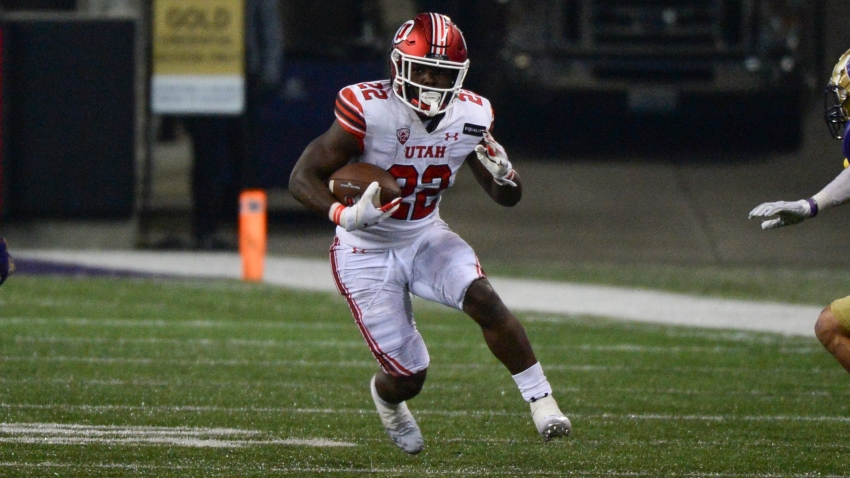 Utah Utes running back Ty Jordan (22) runs the ball during a PAC12 football game between the Utah Utes and the Washington Huskies on November 28, 2020, at Husky Stadium in Seattle, WA. (Photo by Jeff Halstead/Icon Sportswire via Getty Images)