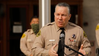 Los Angeles County Sheriff Alex Villanueva addresses a press conference on the steps of the Hall of Justice in downtown Los Angeles providing more details of the arrest of more than 150 people at a Super-spreader event in Palmdale.