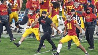 The USC football team.