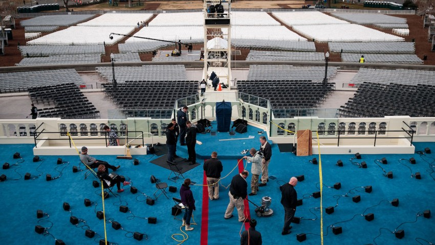 Workers prepare the platform stage on the West Front of the U.S. Capitol one day before the presidential inauguration