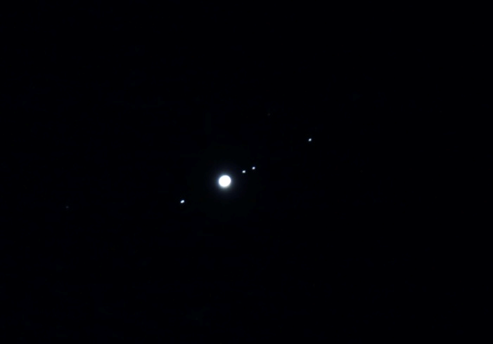 Image of Jupiter and 4 of its largest moons.