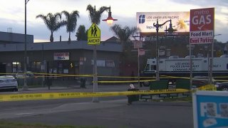 Police tape is pictured at the scene of a shooting in South LA's Florence-Firestone neighborhood.