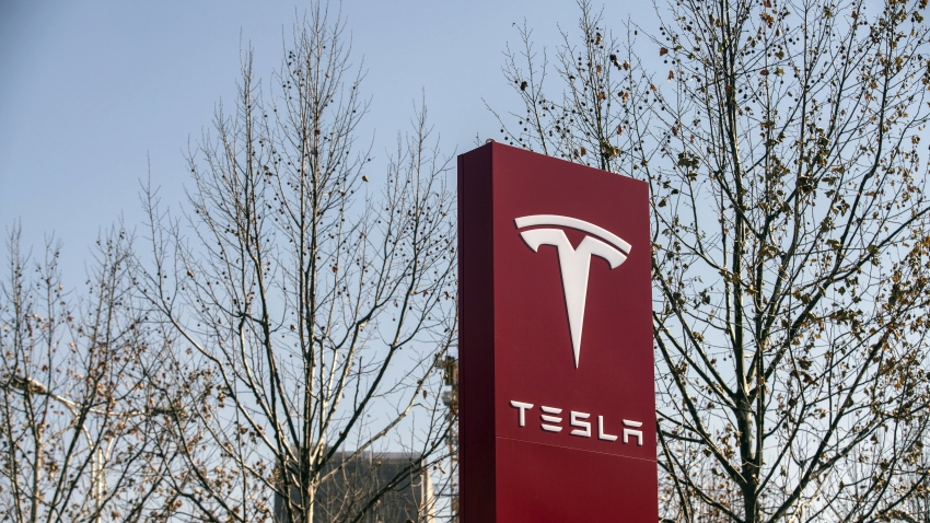 Signage at a Tesla Inc. showroom in Shanghai, China, on Friday, Jan. 8, 2021. Teslacustomers in China wanting to get the new locally madeModelYare facing a longer wait, signaling strong initial demand for the Shanghai-built SUV.