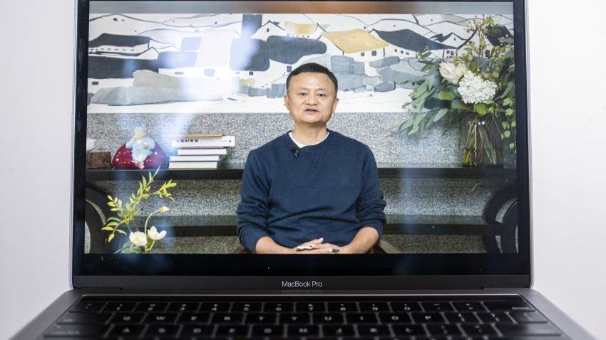 A video recording of a livestream of Jack Ma, co-founder of Alibaba Group Holding Ltd., addressing teachers at an annual event he hosts to recognize rural educators, on a laptop computer arranged in Hong Kong, China, on Wednesday, Jan. 20, 2021. Ma has resurfaced after months out of public view that fueled intense speculation about the plight of the billionaire grappling with escalating scrutiny over his internet empire.