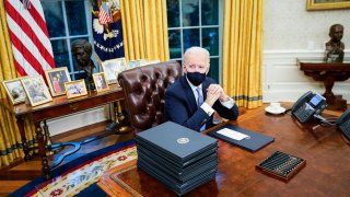 Joe Biden at his desk in the Oval Office