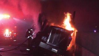 A big rig burns in a deadly freeway crash.