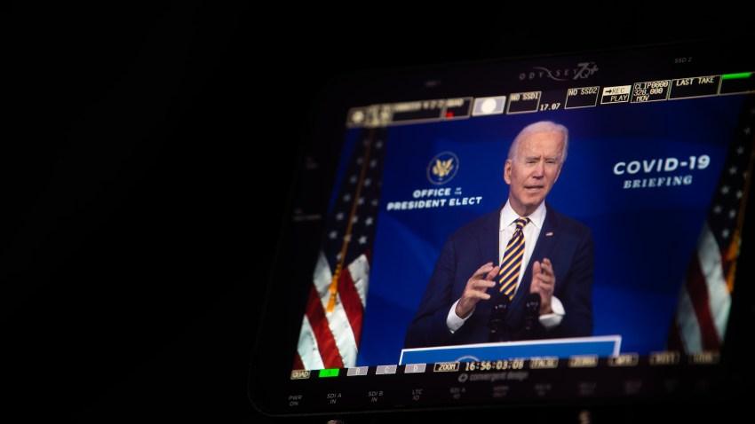 A monitor shows Joe Biden talking