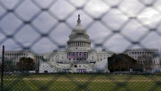 In this Jan. 17, 2021, file photo, the U.S. Capitol is seen behind fences in Washington, D.C.