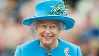 In this Oct. 27, 2016, file photo, Queen Elizabeth II tours Queen Mother Square in Poundbury, Dorset.