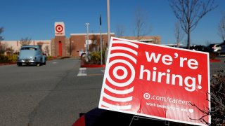 In this Feb. 5, 2021, file photo, a hiring sign is posted in front of a Target store in San Rafael, California.