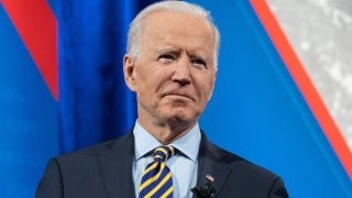 In this Feb. 16, 2021, file photo, President Joe Biden holds a face mask as he participates in a CNN town hall at the Pabst Theater in Milwaukee, Wisconsin.