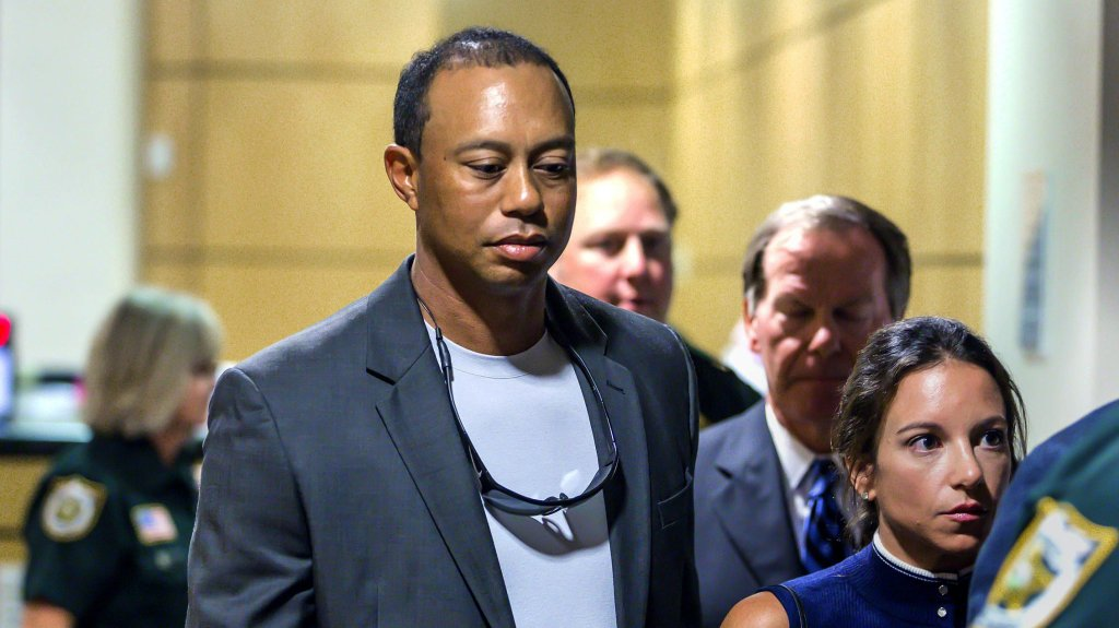 Golfer Tiger Woods leaves the Palm Beach County Courthouse, in Palm Beach Gardens, Fla., Friday, Oct. 27, 2017, after pleading guilty to a charge of reckless driving in connection with his May arrest for driving under the influence.