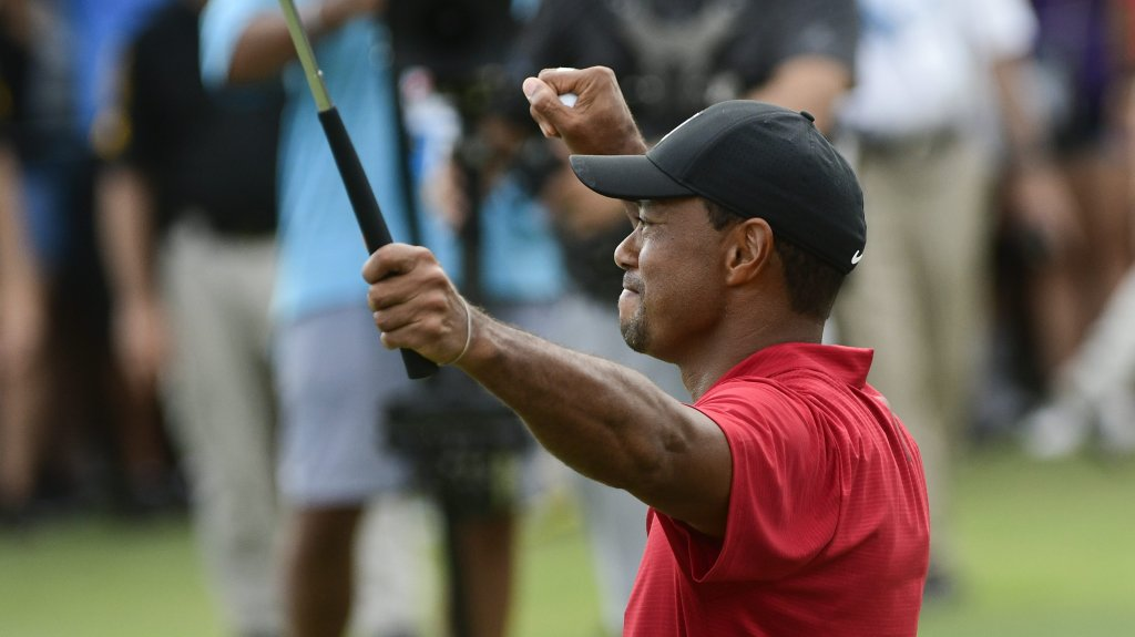 Tiger Woods celebrates on the 18th green after winning the Tour Championship golf tournament Sunday, Sept. 23, 2018, in Atlanta.