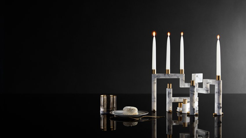 This image provided by Novita Italia shows a Vestalia white marble candlestick holder