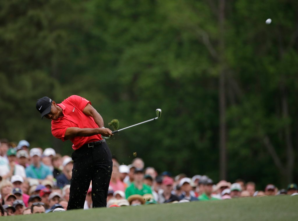 Tiger Woods tees off on the 12th hole during the fourth round of the Masters golf tournament Sunday, April 12, 2015, in Augusta, Ga.