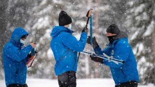 Officials conduct a snow survey in the Sierra Nevada.
