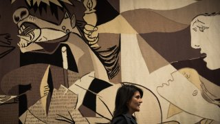 Nikka Haley stands in front of Guernica tapestry