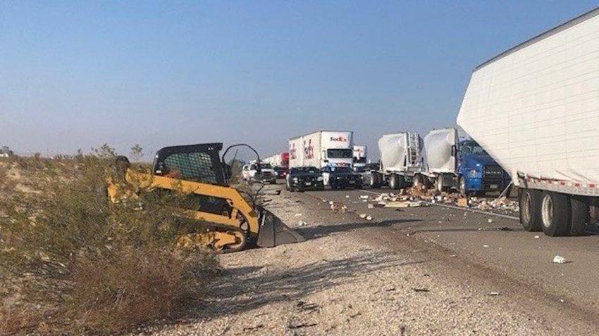 Yogurt cartons spilled onto the 15 Freeway in a big rig crash.
