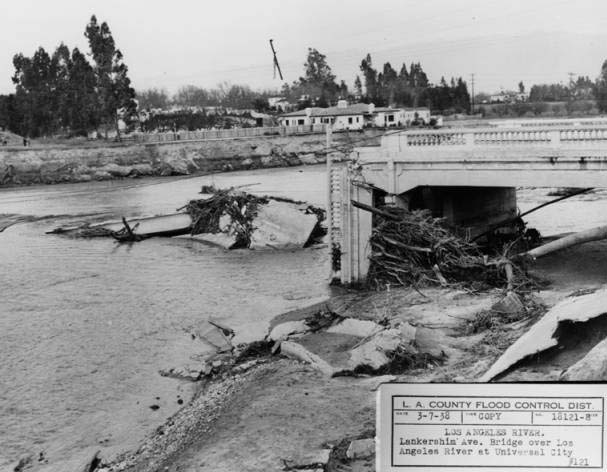 This 1938 image was taken at the confluence of the LA River and the Central Branch of the Tujunga Wash. The flood washed away the Lankershim Blvd Bridge by Universal City. This photo was taken on the south side of the river looking toward the northeast.