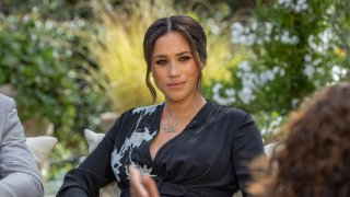 """This image provided by Harpo Productions shows Prince Harry, left, and Meghan, Duchess of Sussex, in conversation with Oprah Winfrey. """"Oprah with Meghan and Harry: A CBS Primetime Special"""" aired March 7, 2021."""