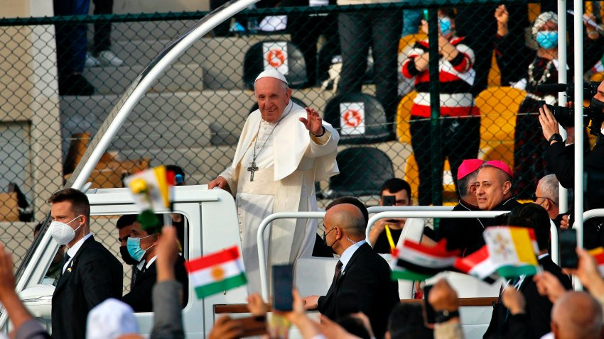 Pope Francis waves as he arrives for an open air Mass at a stadium in Irbil, Iraq
