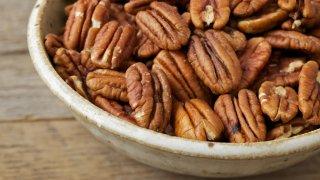 Bowl of pecan nuts.