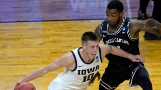 Iowa's Joe Wieskamp (10) drives to the basket between Grand Canyon's Jovan Blacksher Jr. (10) and Oscar Frayer during the first half of a first round NCAA college basketball tournament game Saturday, March 20, 2021, at the Indiana Farmers Coliseum in Indianapolis.