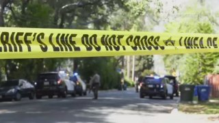 Deputies are seen at the site of a slaying in Altadena.