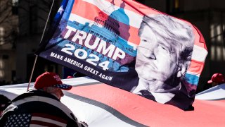 protesters supporting former President Donald Trump march down Fifth Avenue
