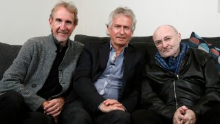 Genesis band members from left, Mike Rutherford, Tony Banks, and Phil Collins pose for a photo